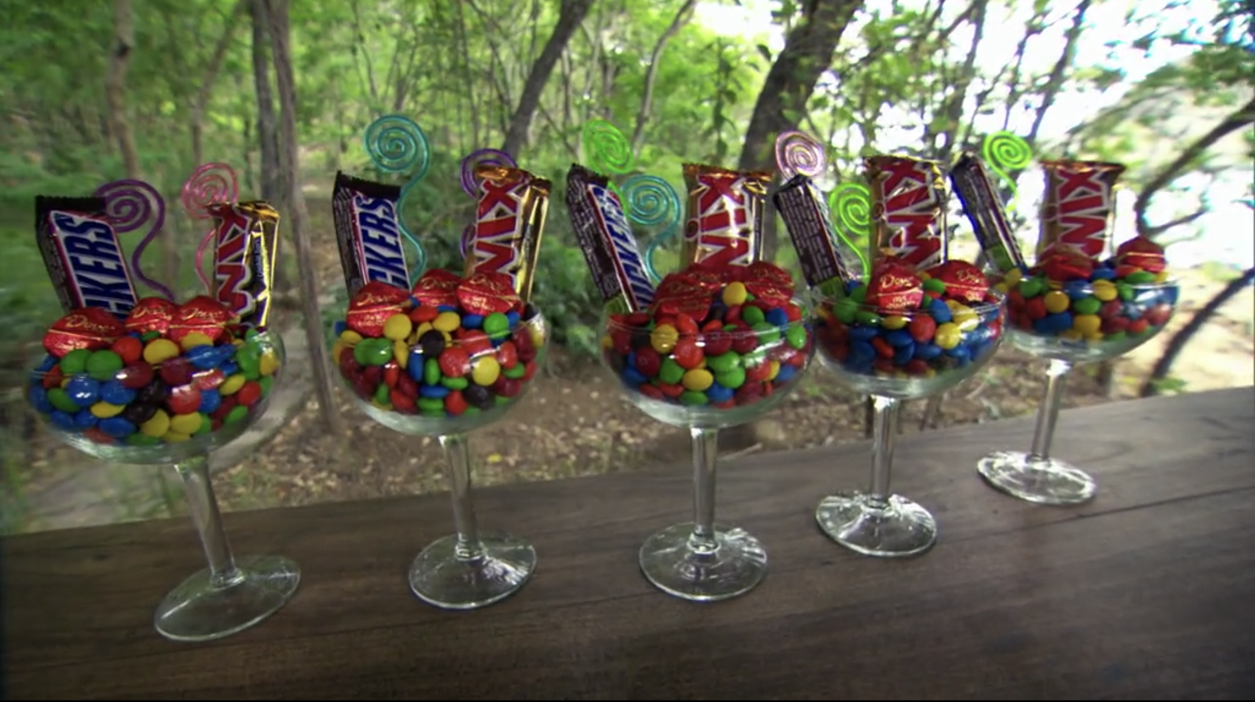 A line of glasses holding Mars Chocolate products