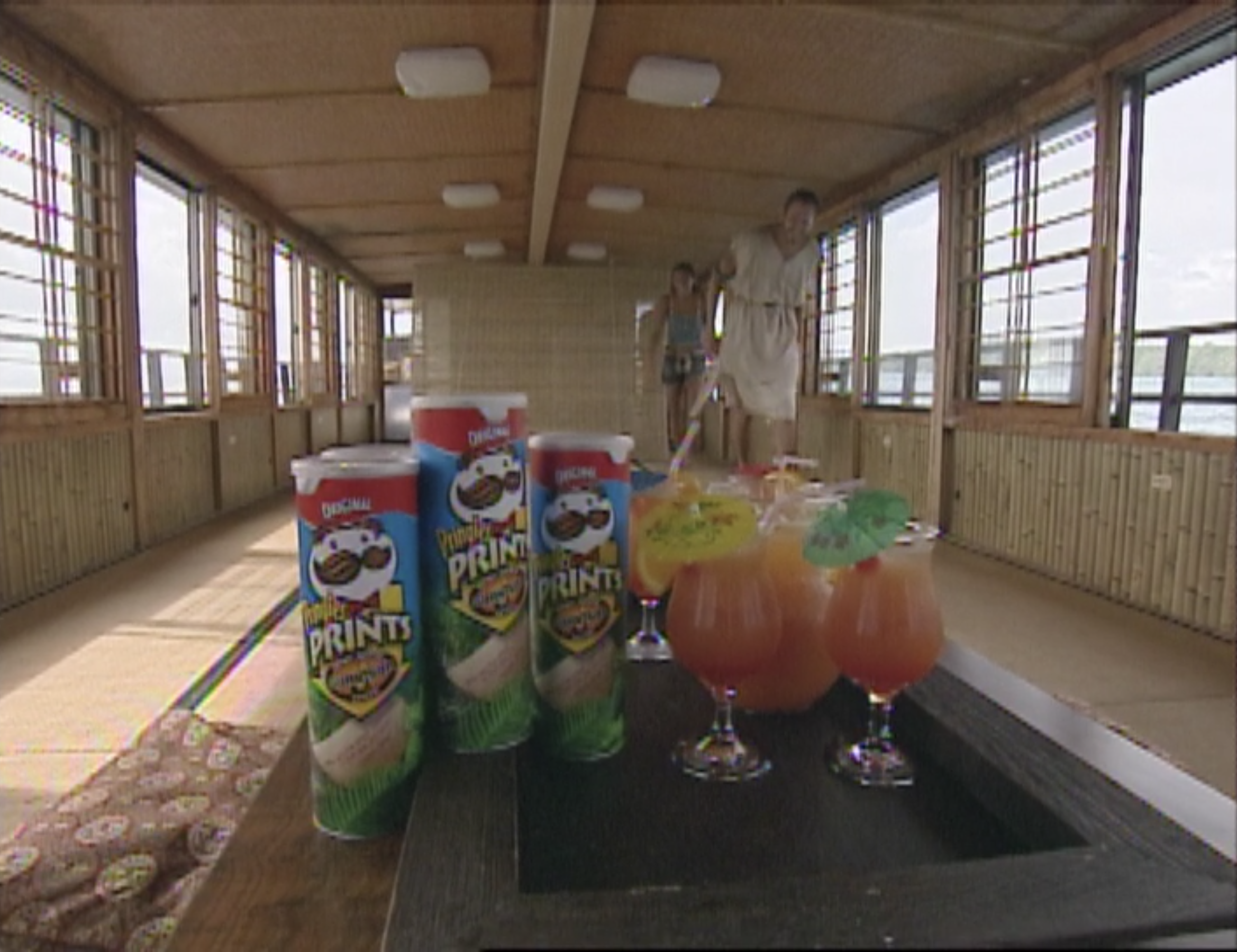 Several cans of Survivor Trivia Pringles next to Mai-Tais