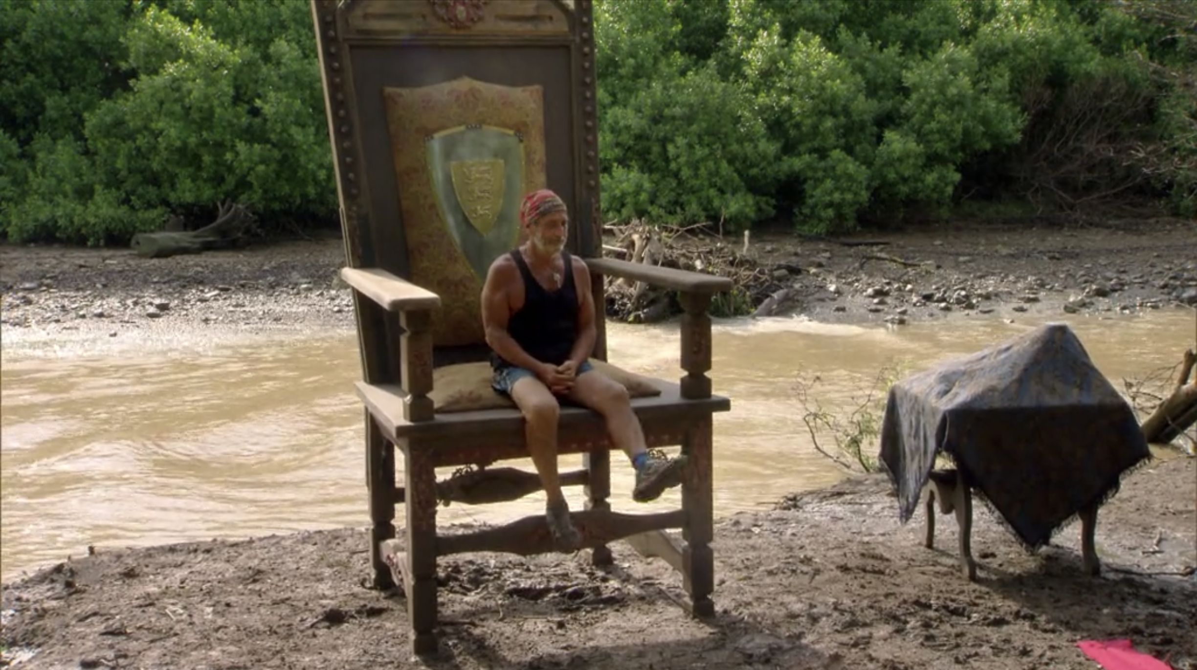 Dan Lembo sits in a large chair during a Gulliver's Travels themed challenge