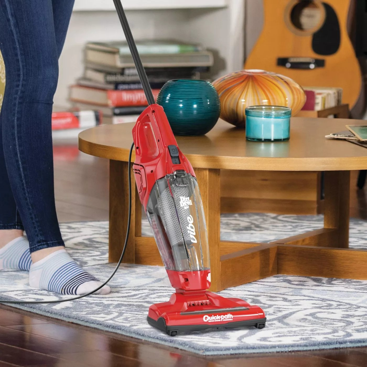 The red vacuum with a handheld vacuum