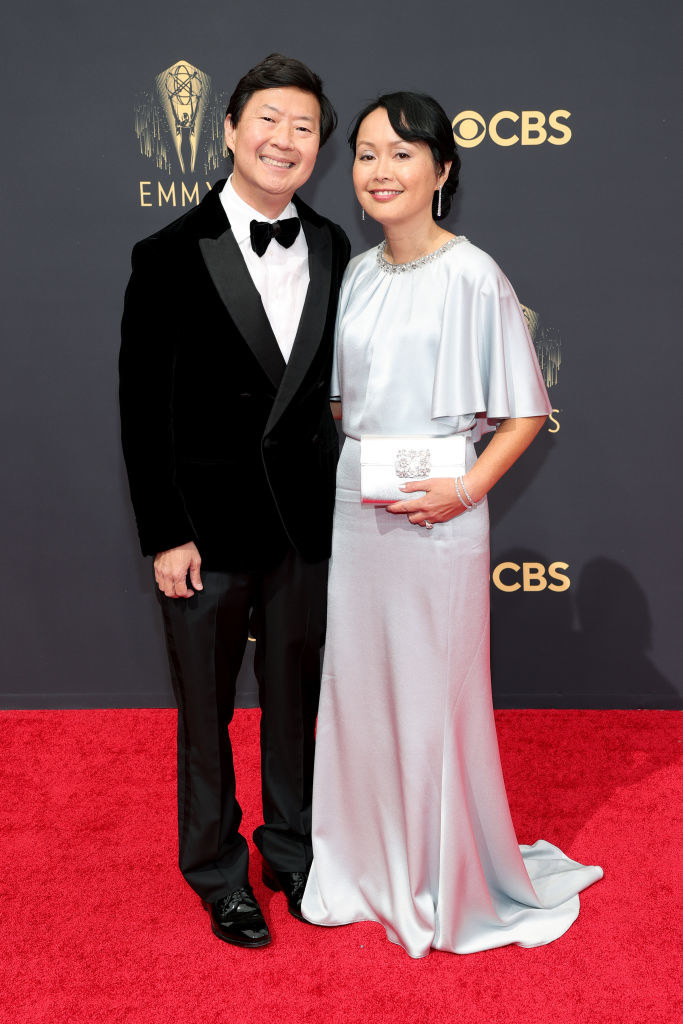 Ken Jeong and Tran Jeong on the red carpet: Ken wears a standard black tux and Tran wears a gorgeous light blue satin gown