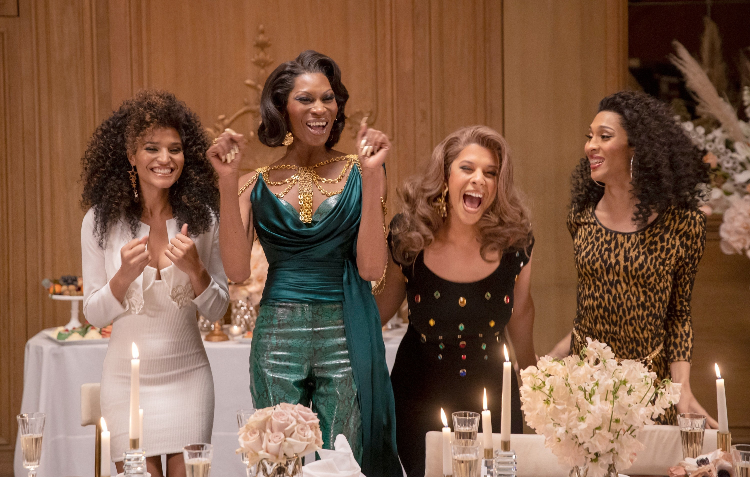 The cast of Pose at a candlelit dinner in a scene from Pose
