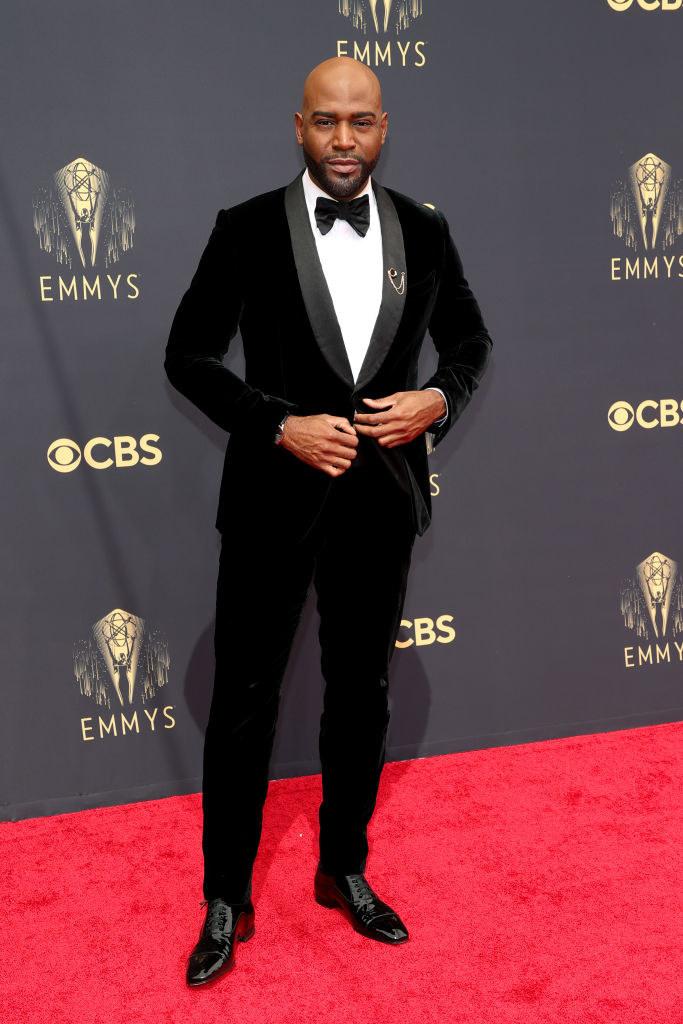 Karamo Brown on the red carpet in a black velvet tux