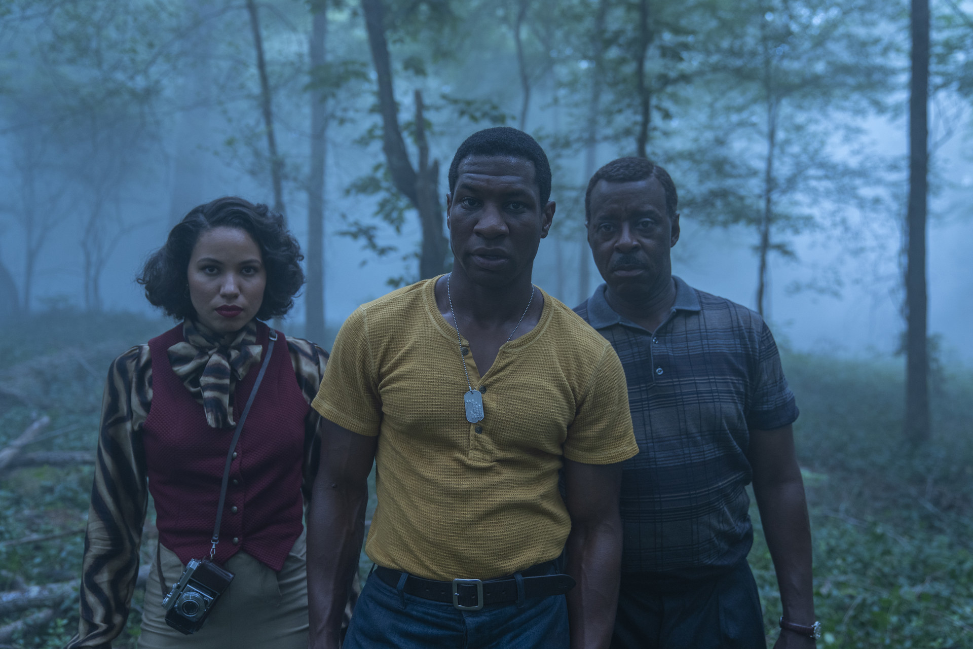 Atticus, Leti, and George walking through a foggy forest
