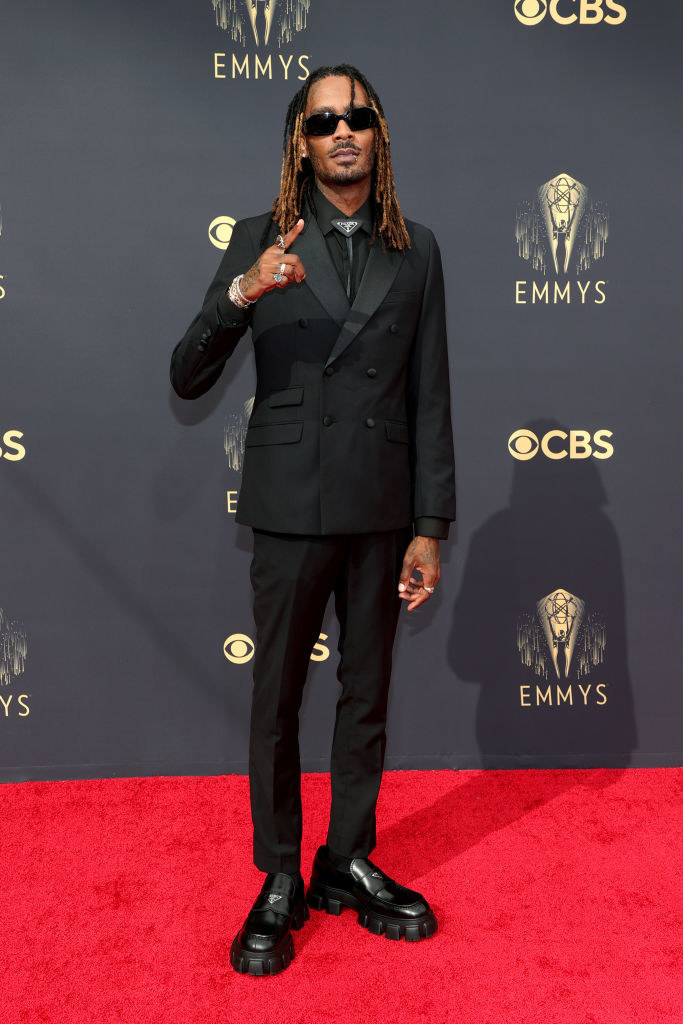 GaTa on the red carpet in an all black suit