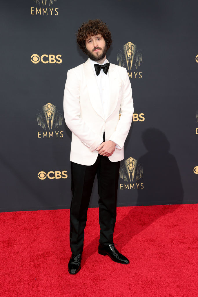 Dave Burd on the red carpet in a white suit jacket and black trousers