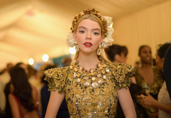 Anya wore an embroidered and embellished gown with pagoda shoulders and a matching headband
