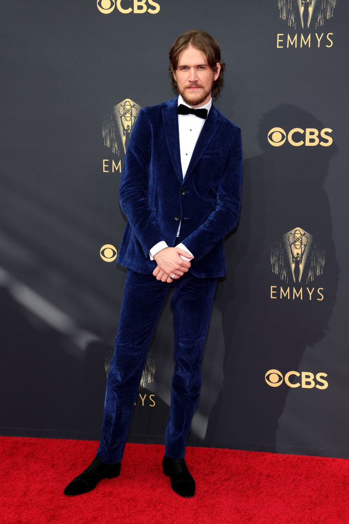 Bo Burnham on the red carpet in a dark blue velvet suit