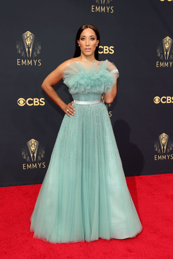 Robin Thede on the red carpet in a fluffy teal tulle gown