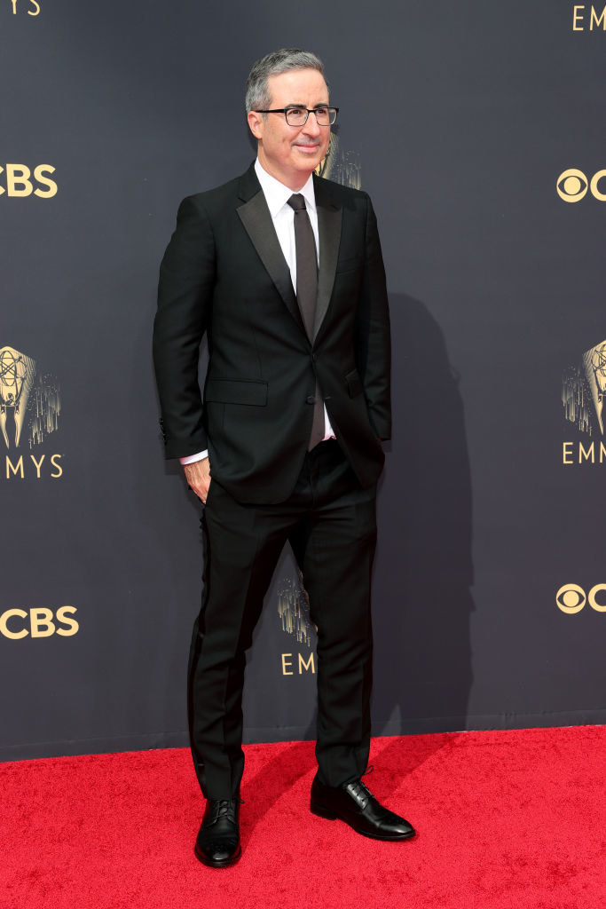 John Oliver on the red carpet in a classic black suit