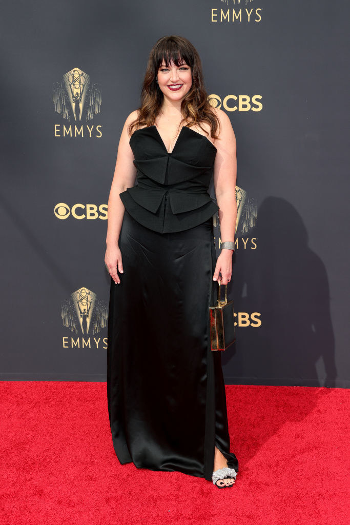 Kathryn Burns in a black satin gown on the red carpet
