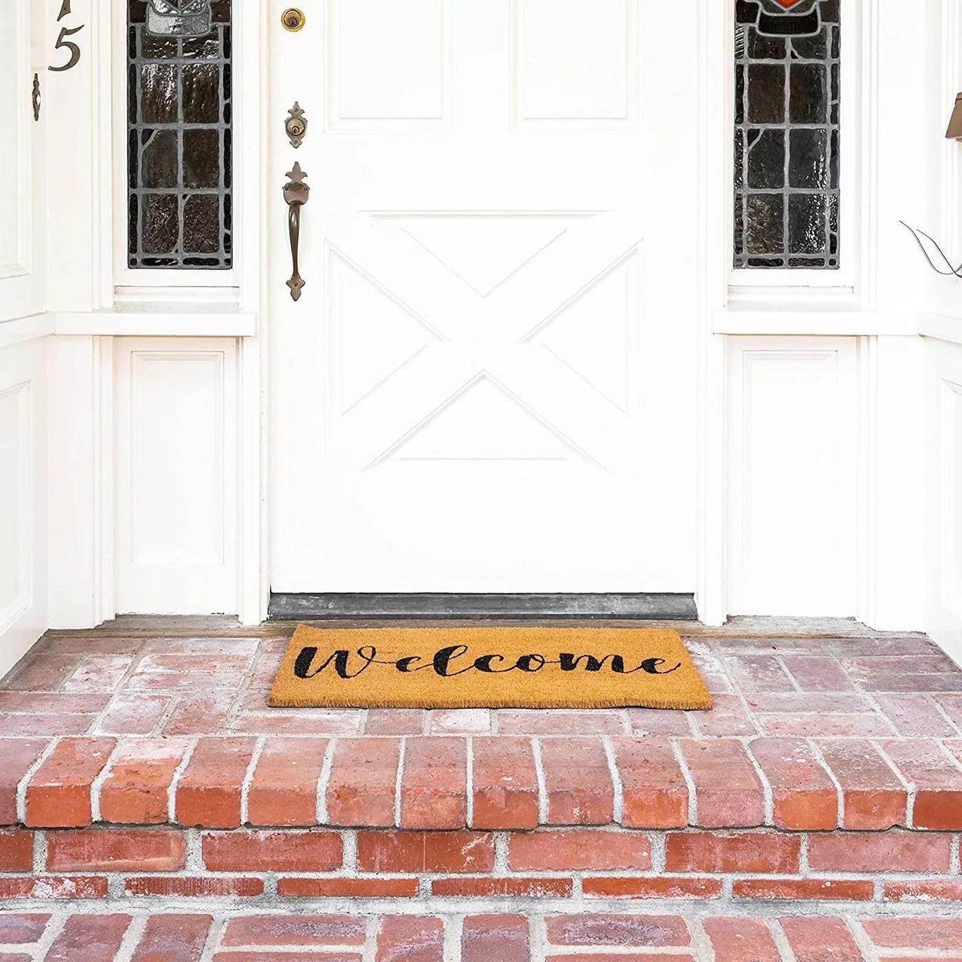 The welcome door mat