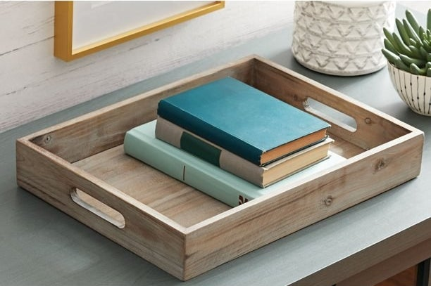 wooden tray with books inside