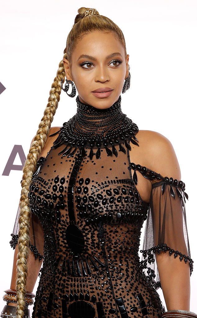 Beyonce posing in a sheerbeaded dress