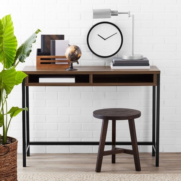 walnut colored desk with two shelves