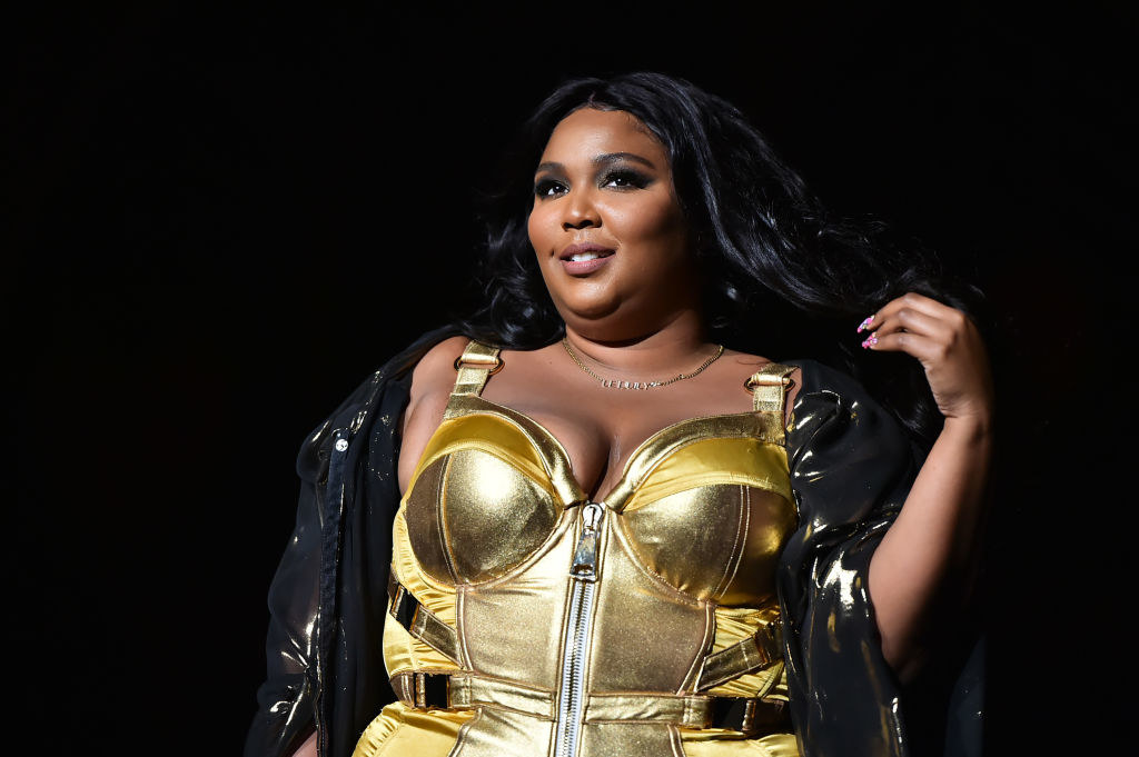 Lizzo in a gold bustier dress