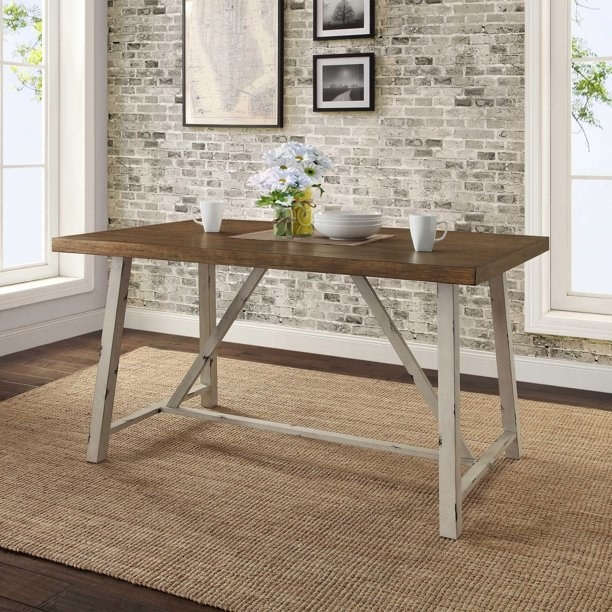 wood dining table with white metal base