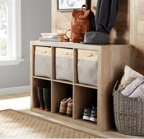 rustic gray 6-cube organizer shelf with baskets and shoes inside