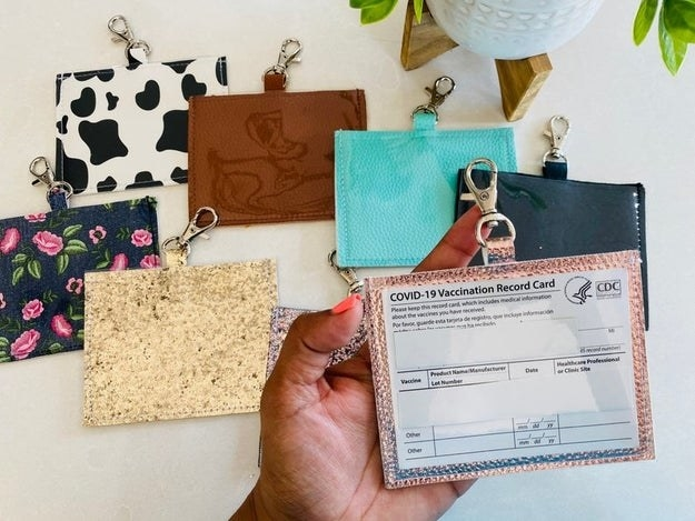 eight different vaccine card holders in various prints, colors, and glitter