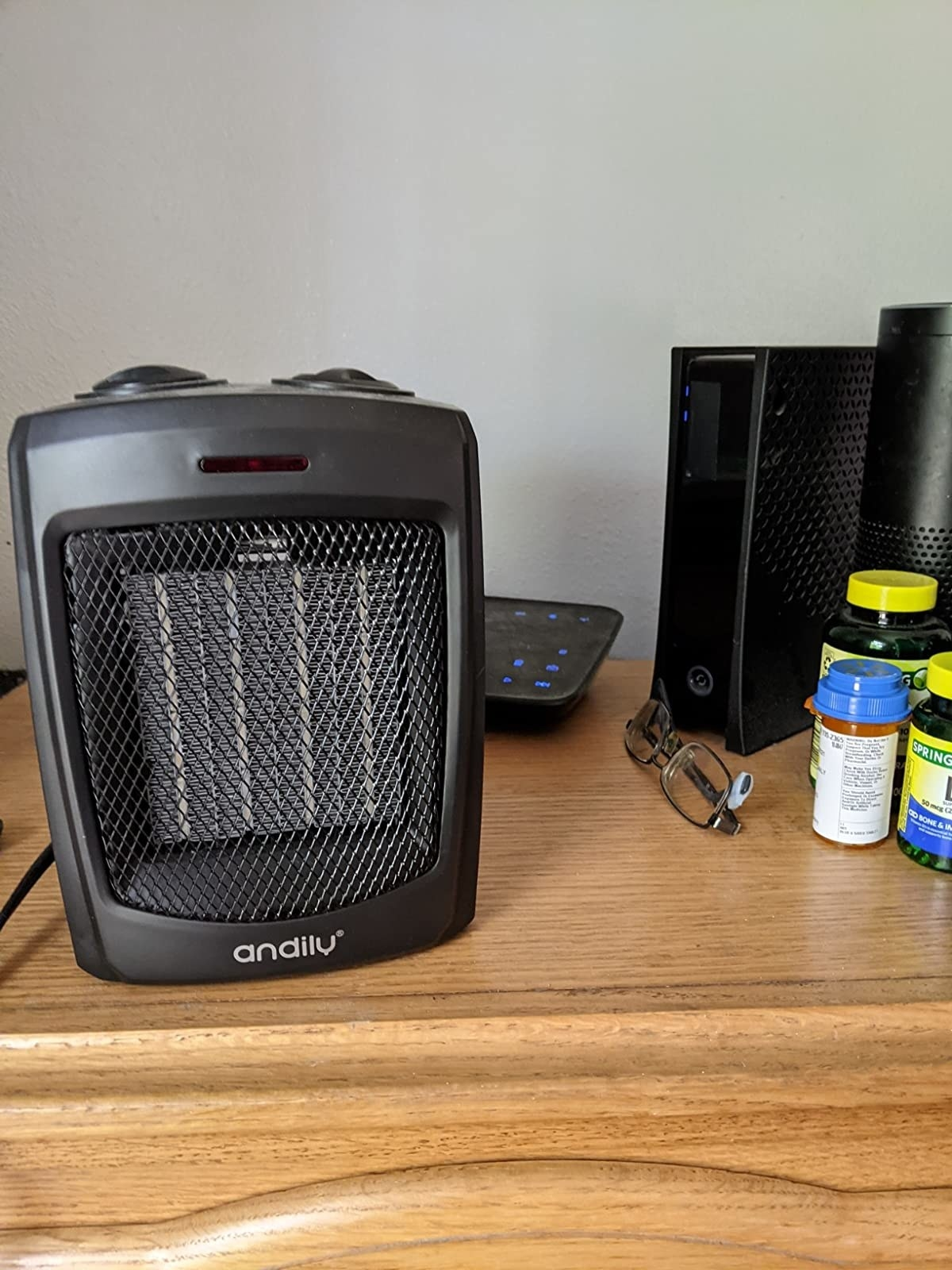 reviewer image of the portable space heater on a dresser