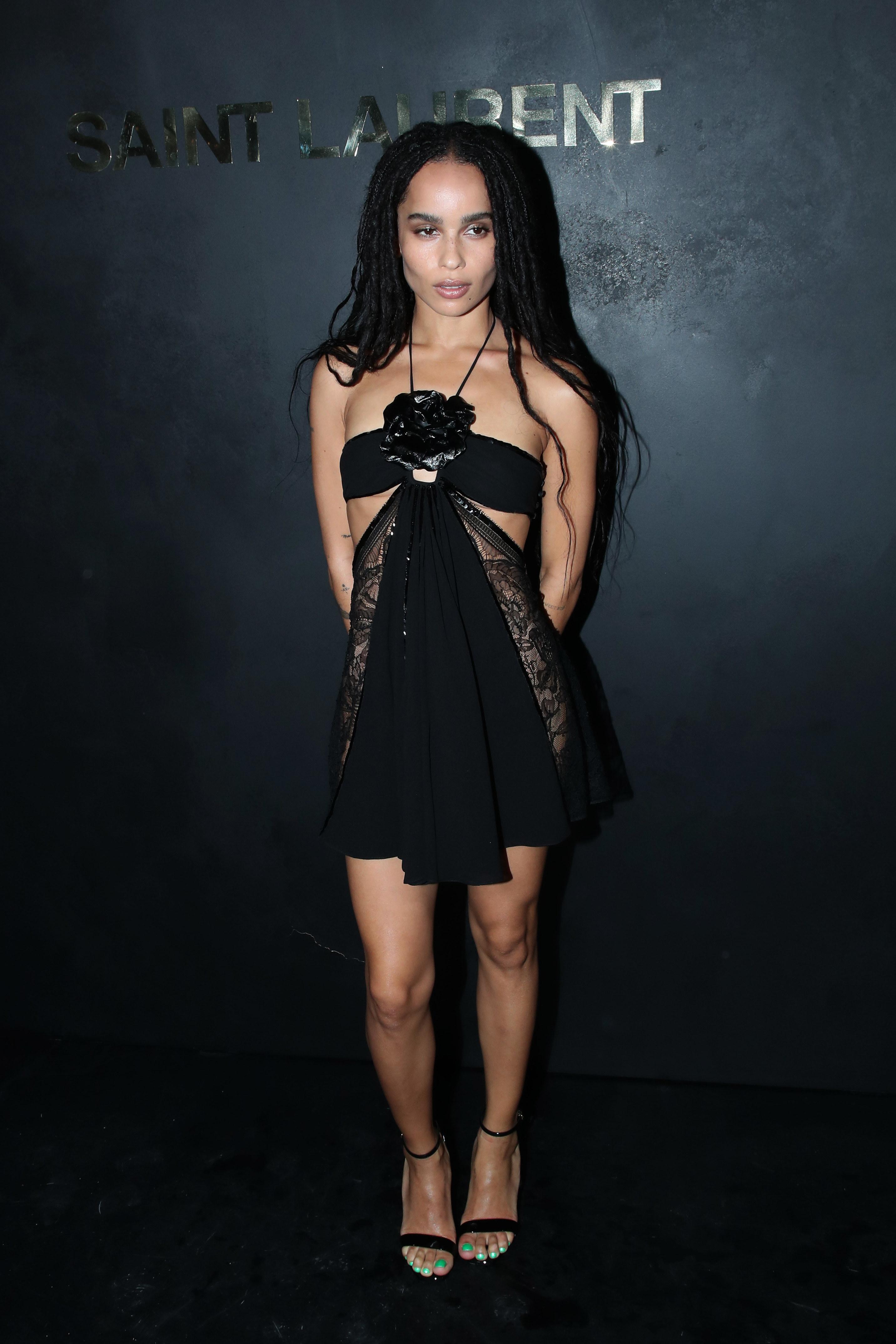 Zoe in small black lacy dress