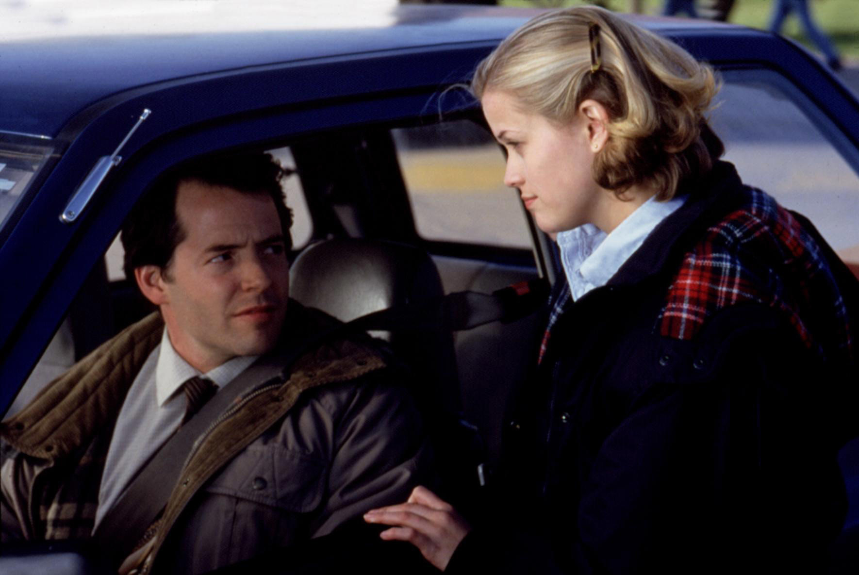 Matthew Broderick in a car talking to Reese Witherspoon outside it