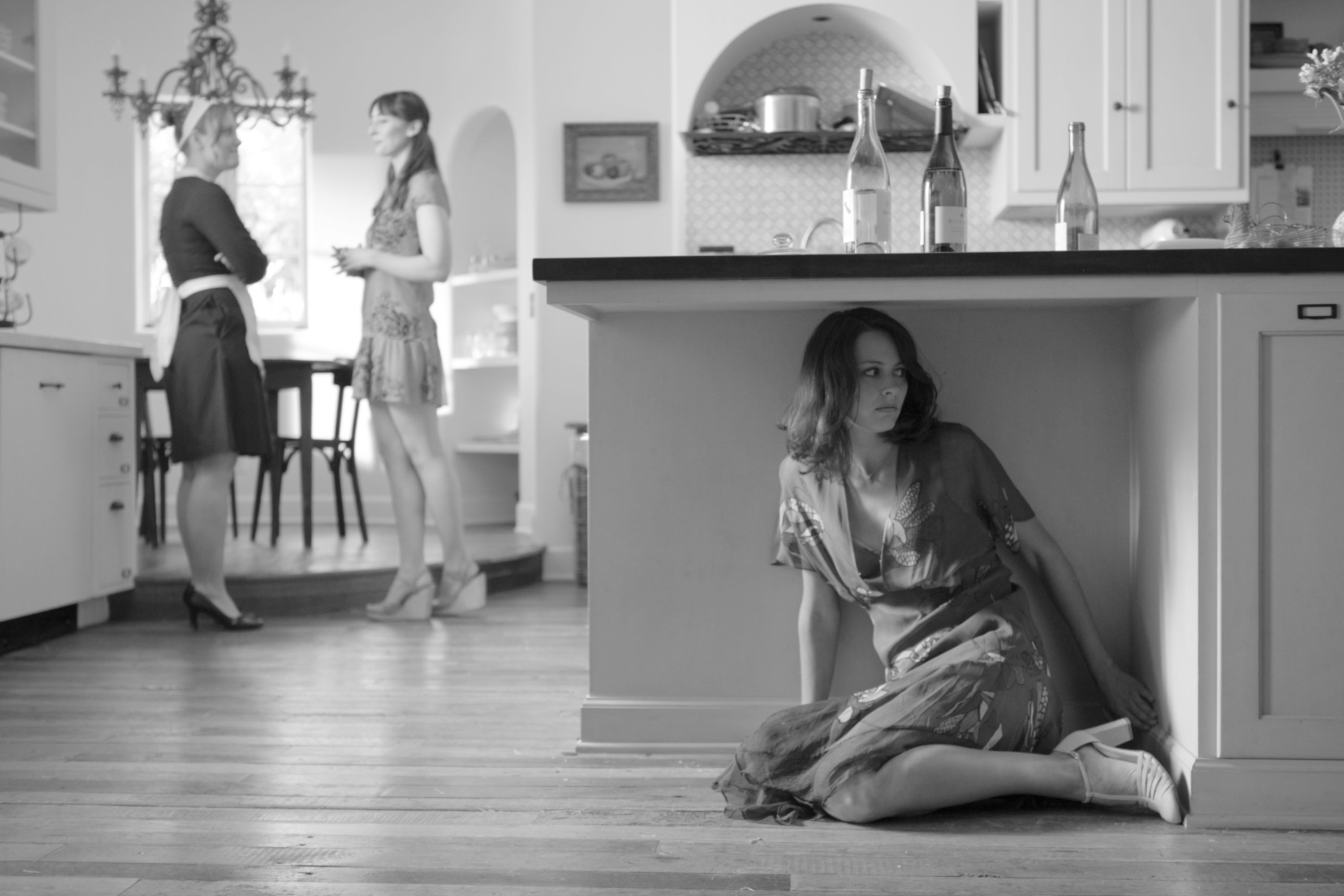 Amy Acker hiding in the kitchen.
