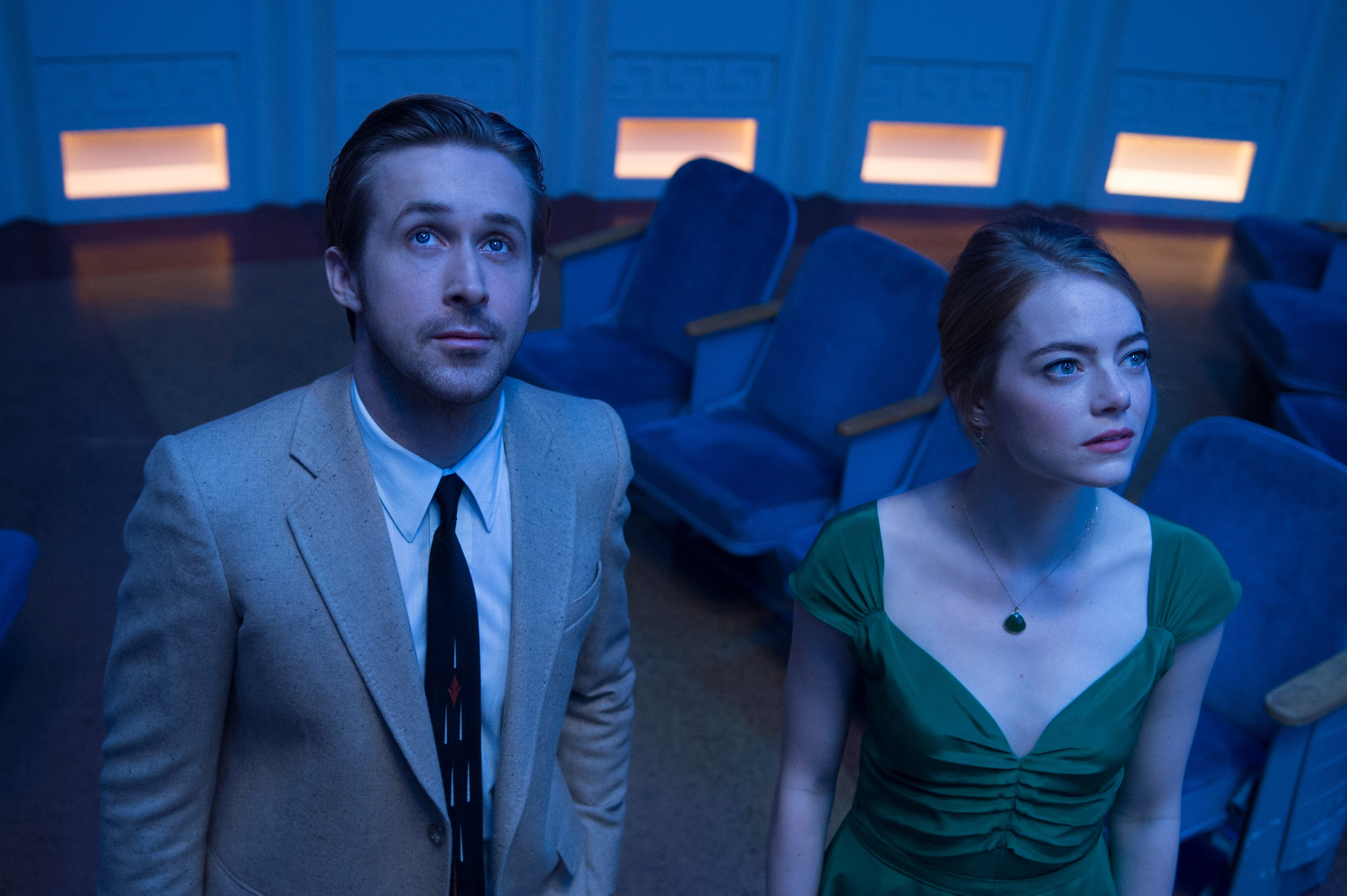Ryan Gosling and Emma Stone looking up