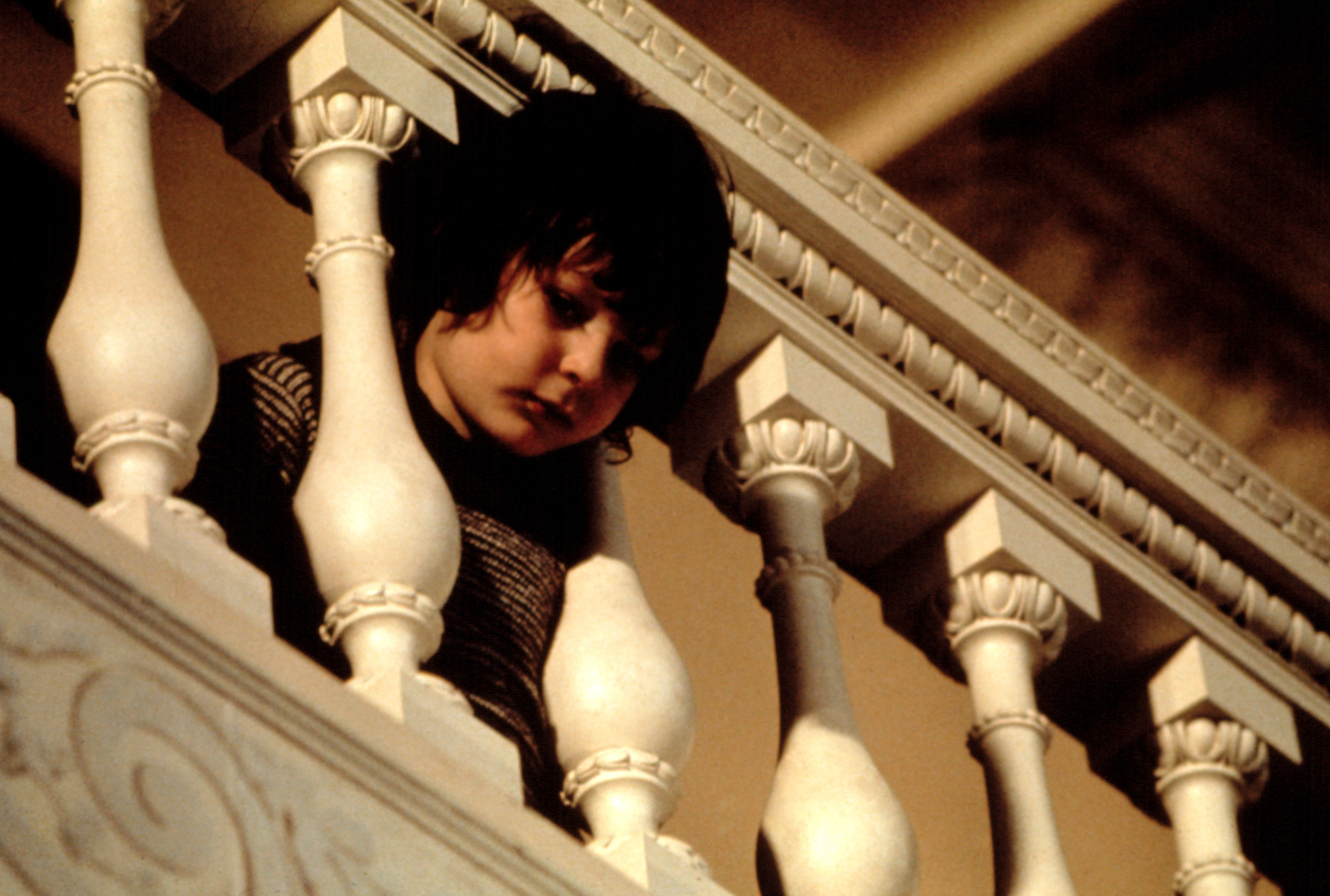 Harvey Stephens has his head between the bannisters
