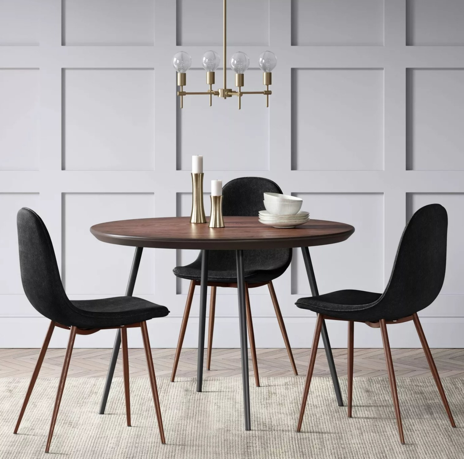 a brown table with the modern chairs in black surrounding it