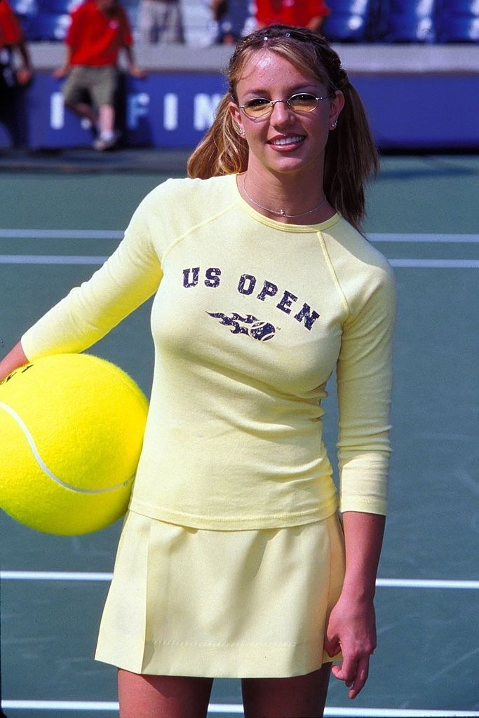 Britney Spears in a yellow matching set and tiny sunglasses
