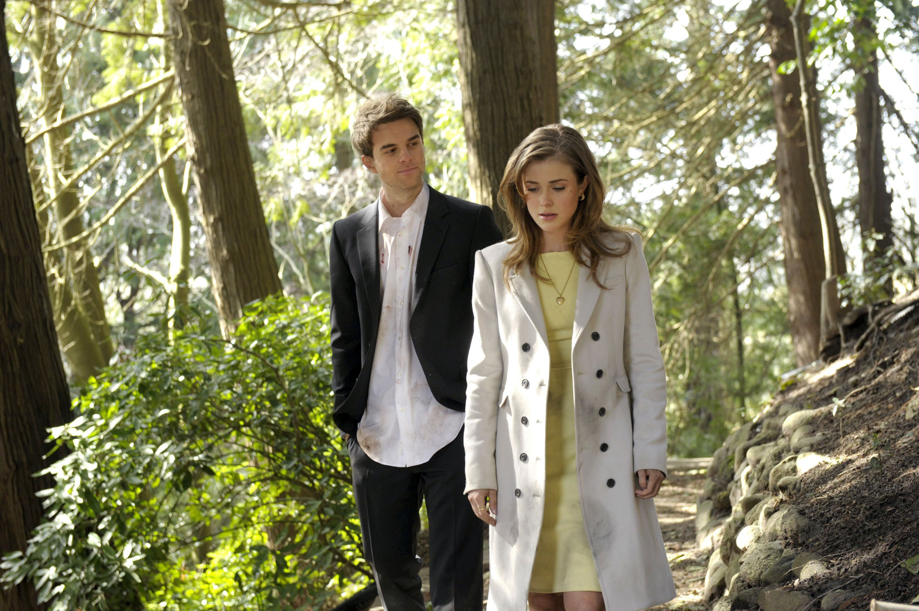 Nathaniel Buzolic and Melissa Roxburgh in the woods