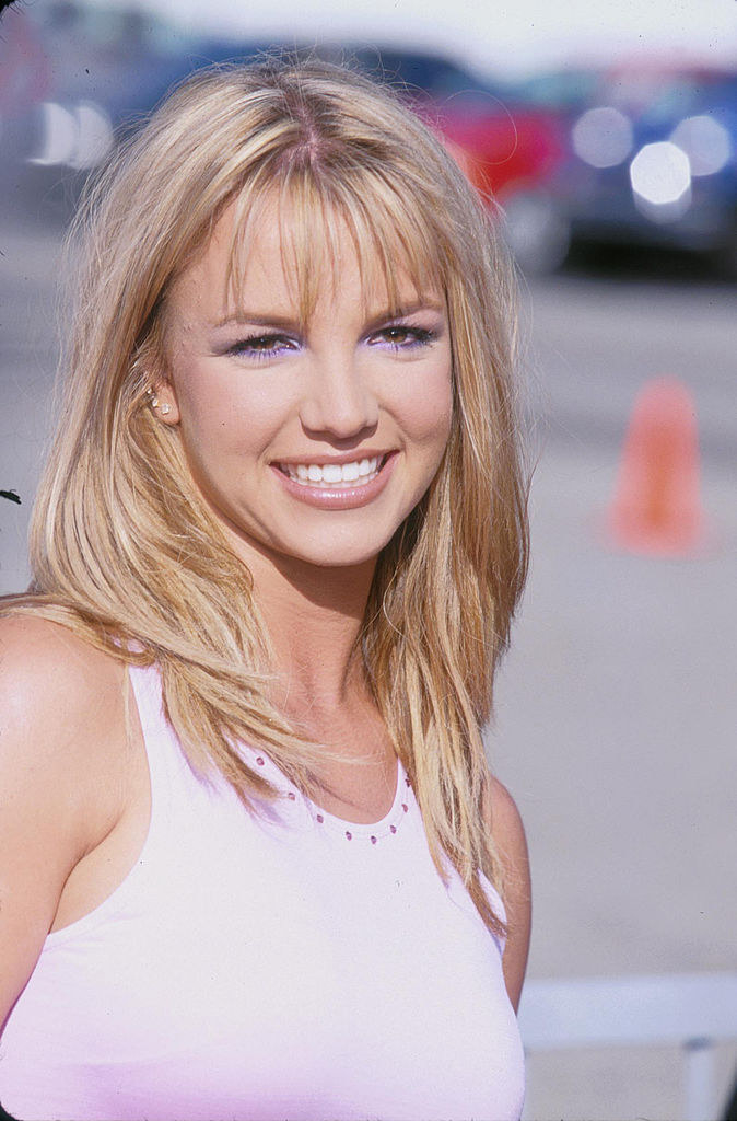 Photo of Britney in a pink tank top and purple eyeshadow
