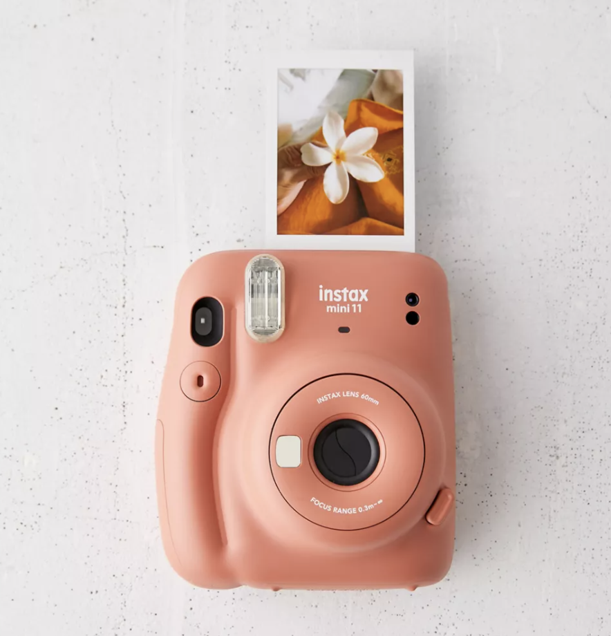 A rust colored instant camera
