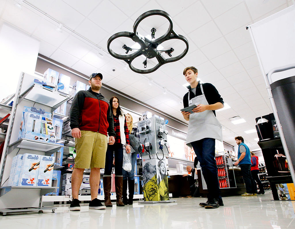 Someone flies a drone for customers in a Brookstone