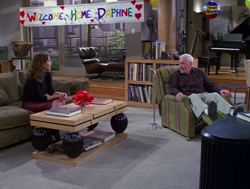 Roz and Martin talking with the paw print covered banner behind them