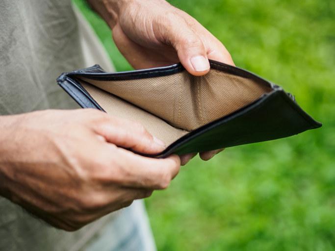 A man opening an empty wallet