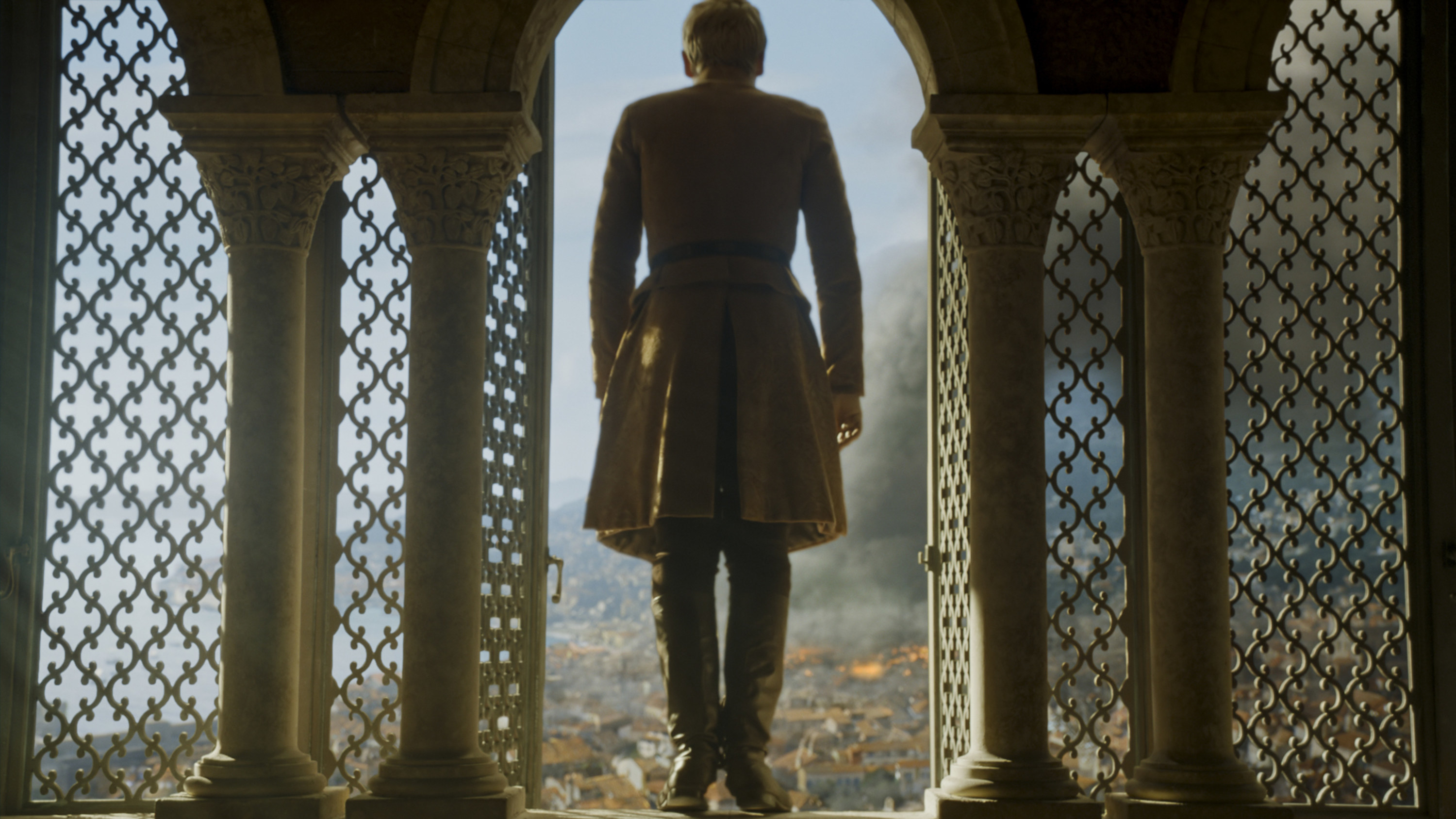 Tommen stepping out of his window as the city burns