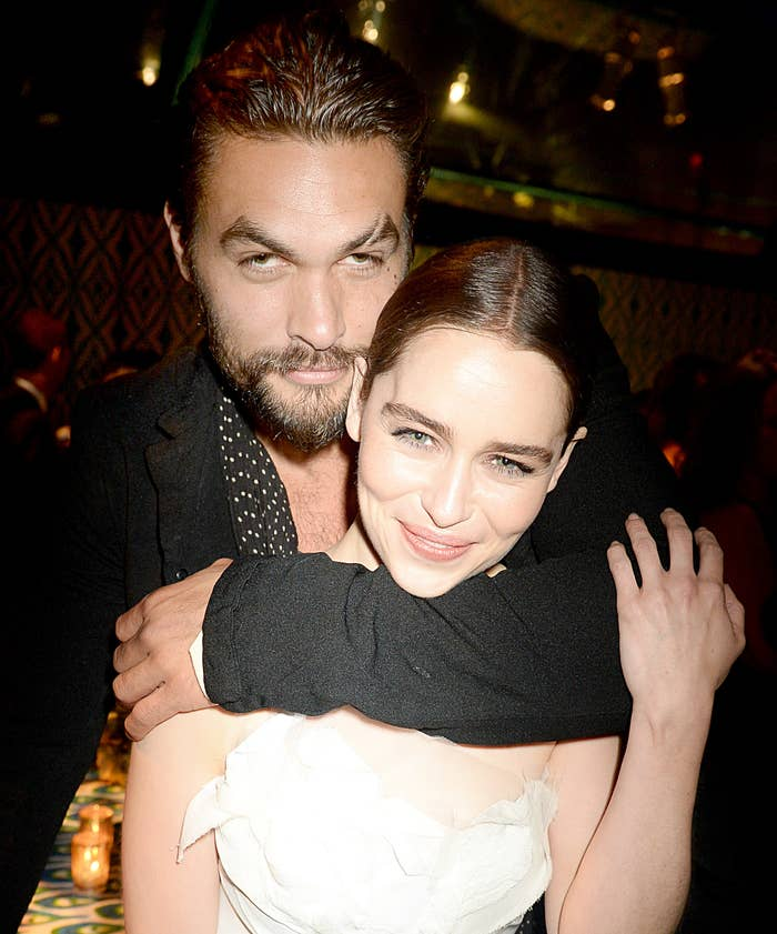 Jason hugs Emilia from behind at a party