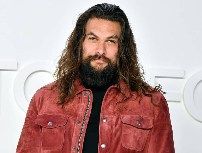 Jason wears a red suede jacket to an event