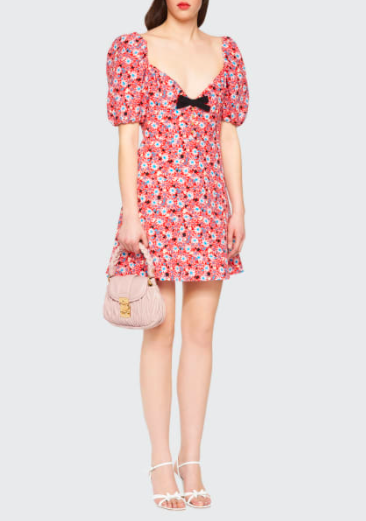 A model wearing a floral dress by The Row
