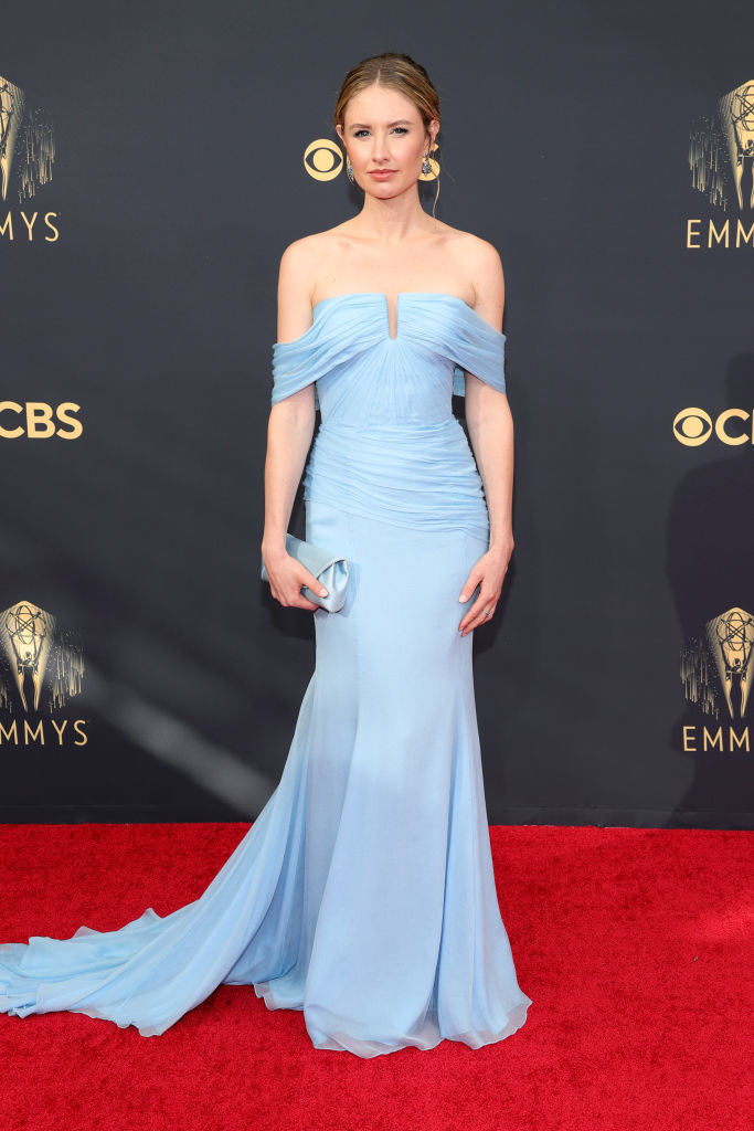 Caitlin Thompson on a red carpet in a light blue gown