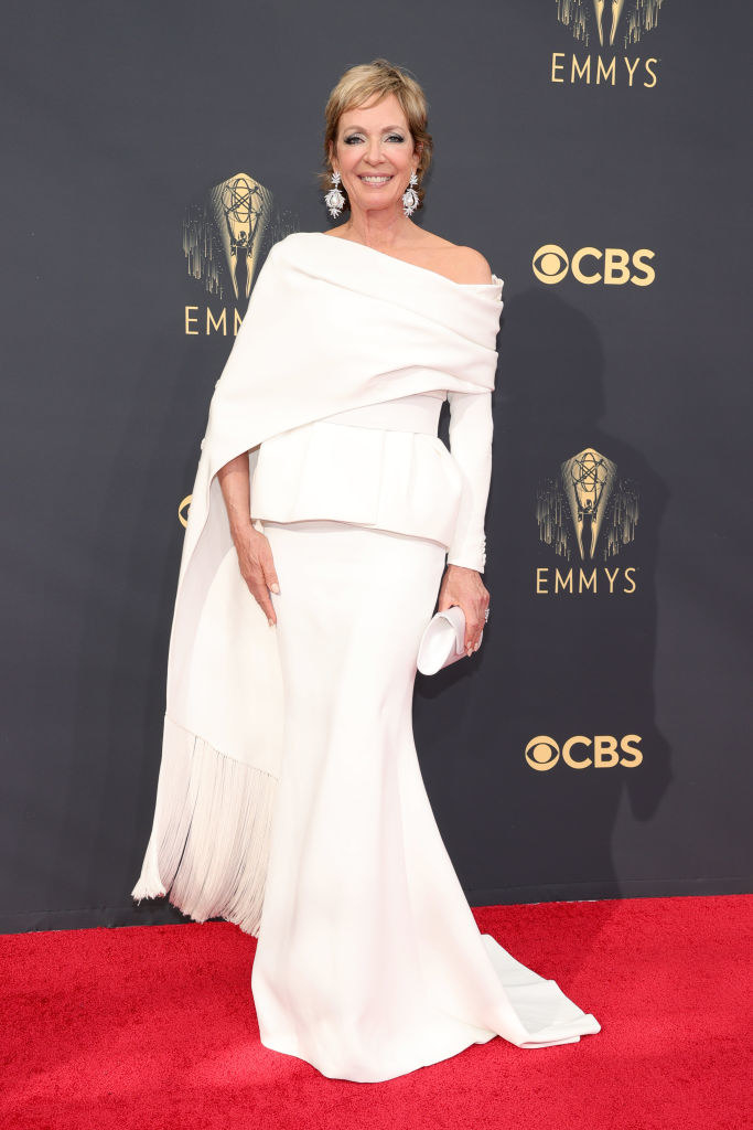 Allison Janney on the red carpet in a white gown