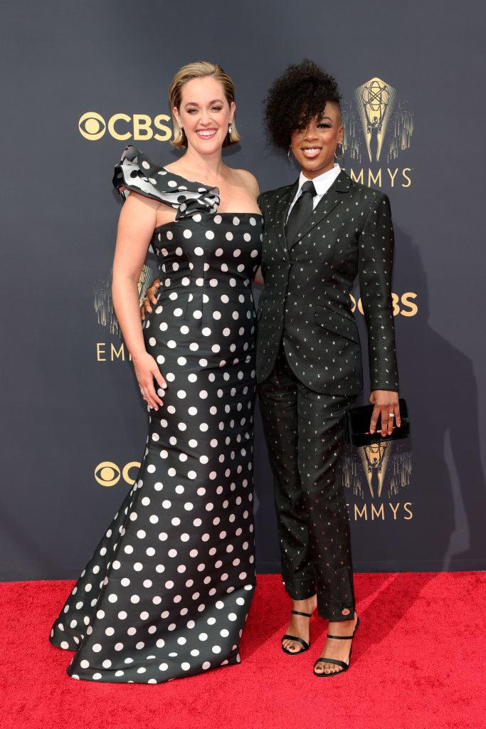Lauren Morelli wears a polka dot one shoulder gown and Samira Wiley wears a dark bedazzled suit