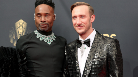 A close up ofBilly Porter and Adam Smith
