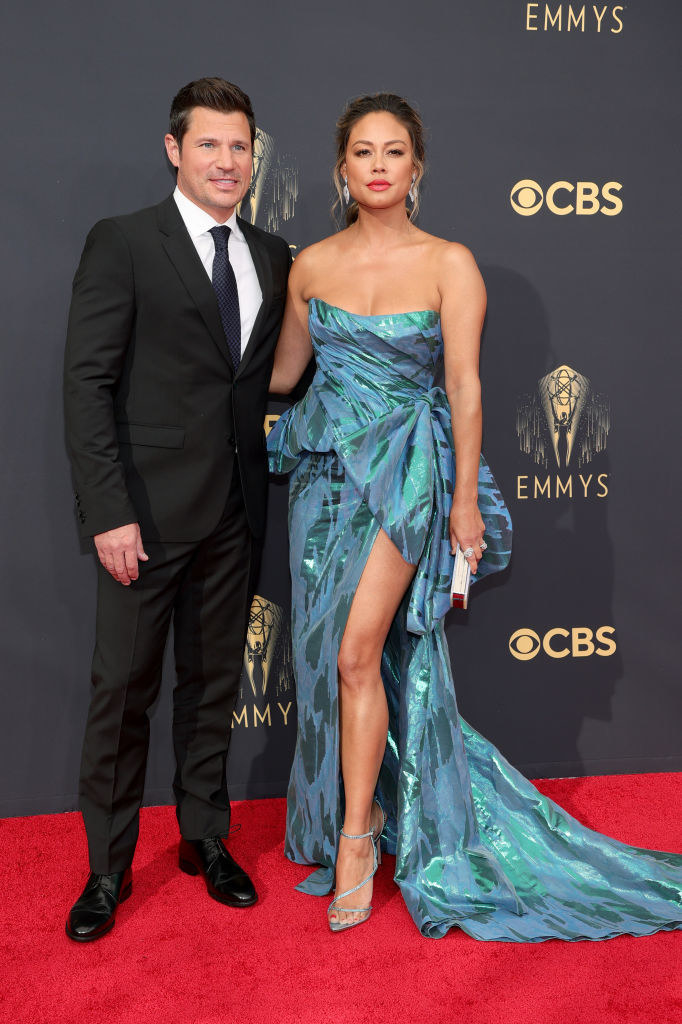 NickLachey wears a dark suit and VanessaLachey wears a brightly colored strapless gown