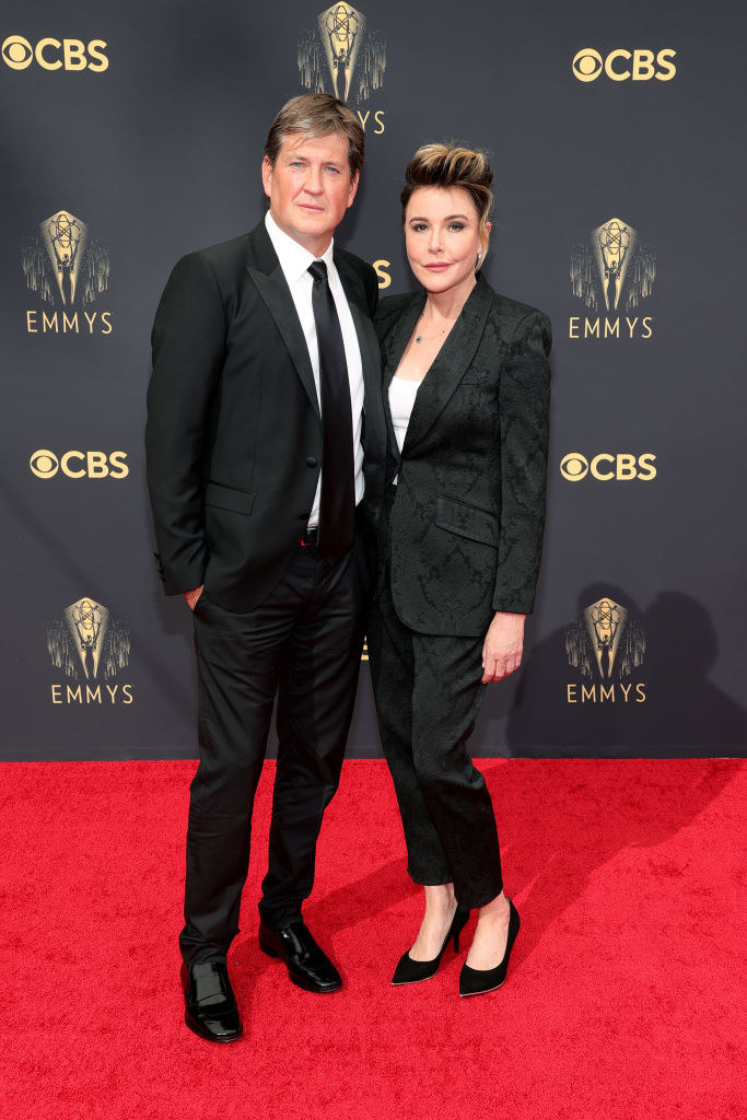 Bill Lawrence and Christa Miller wear dark suits