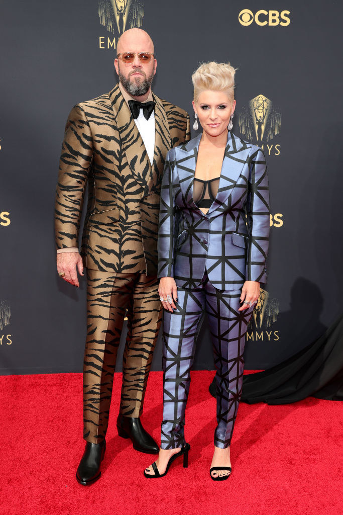 Chris Sullivan wears a tiger striped suit and Rachel Sullivan wears a dark colored suit with stripes