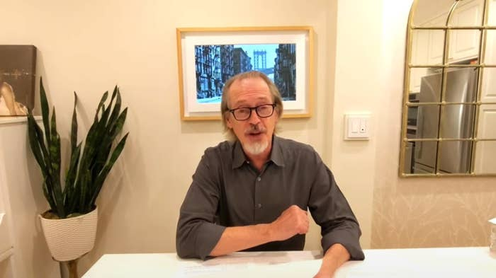 Steve sitting down at a table and speaking to a camera