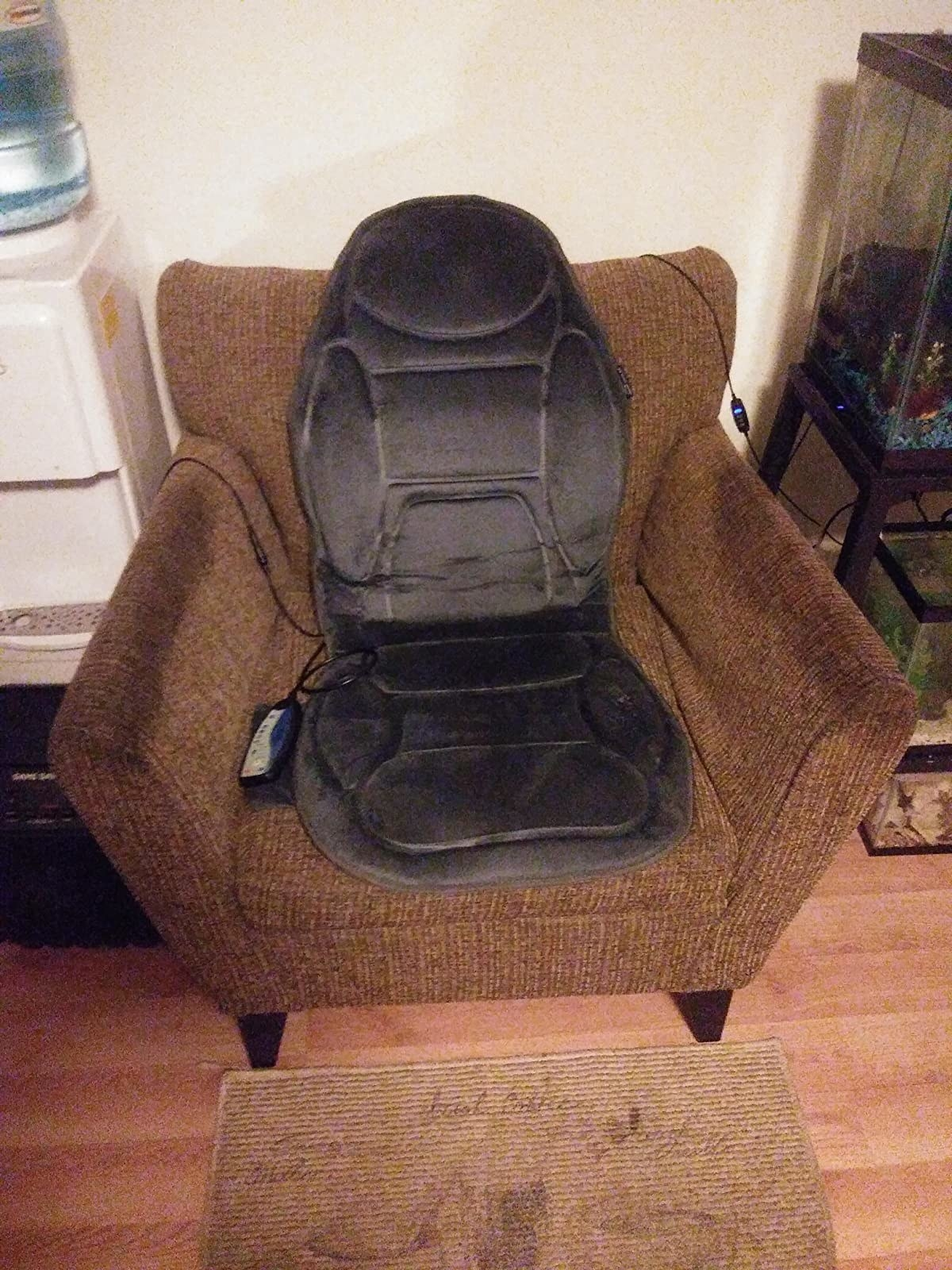 A reviewer's armchair with the massage cushion with remote control